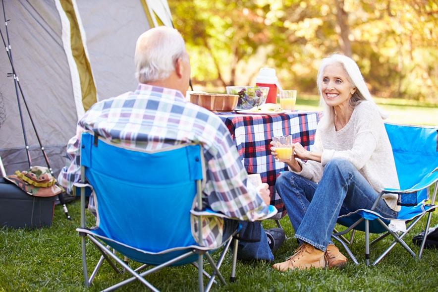 senior couple enjoying camping - Medicare Open Enrollment 2018