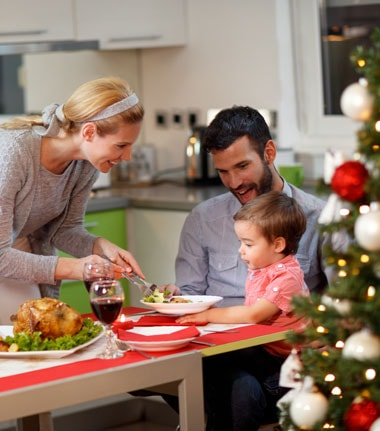 Family celebrating christmas happy - aetna information